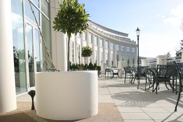 White planter outside a hotel